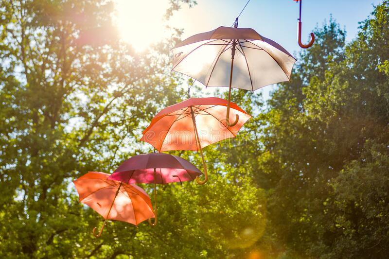 Umbrella`s with the sun shining on them royalty free stock photos