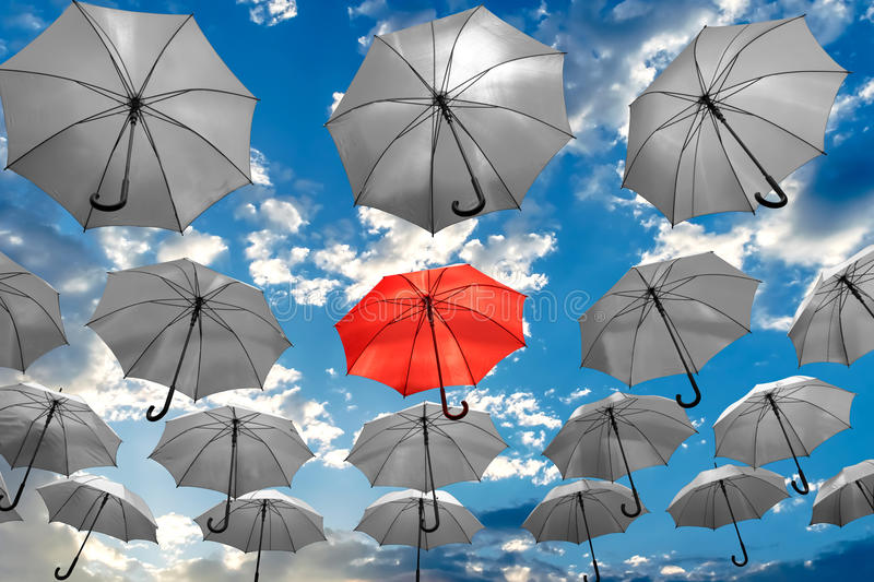 Umbrella standing out from the crowd unique concept mental health depression royalty free stock image