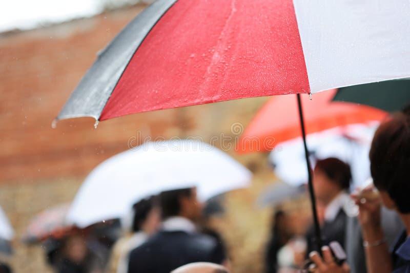 An umbrella under the rain royalty free stock photo