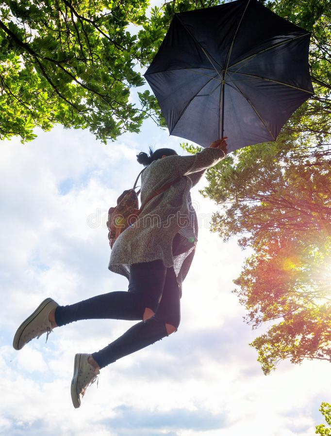 Umbrella woman jump in forest at sunset royalty free stock photos