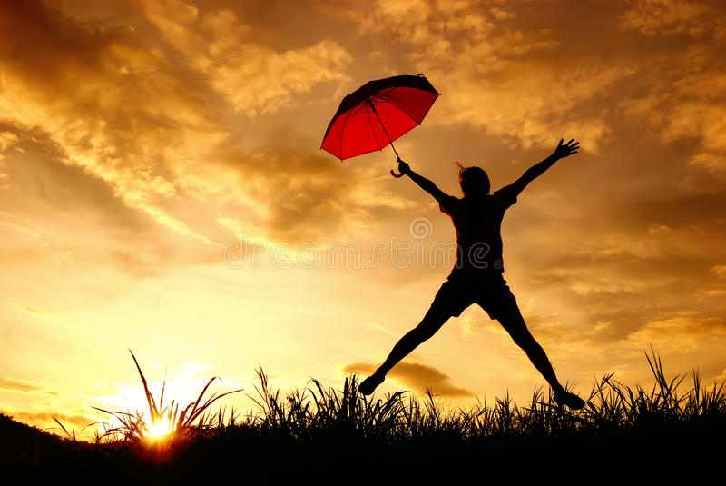 Download Umbrella Woman Jump And Sunset Silhouette In Lake Stock Photo - Image of lake, hold: 24218304