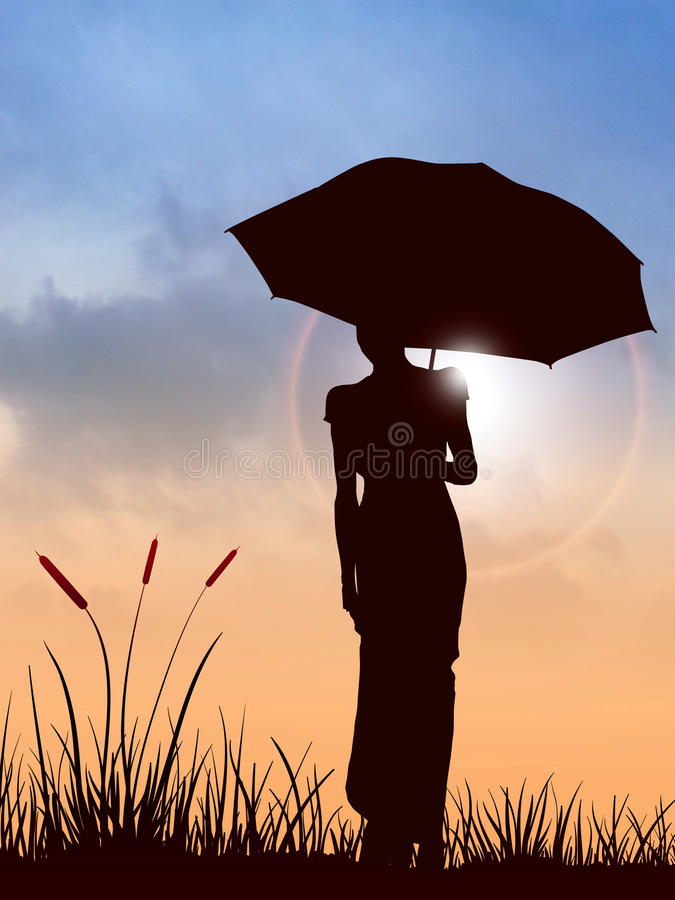 Umbrella woman and sunset. Silhouette woman and morning royalty free stock image