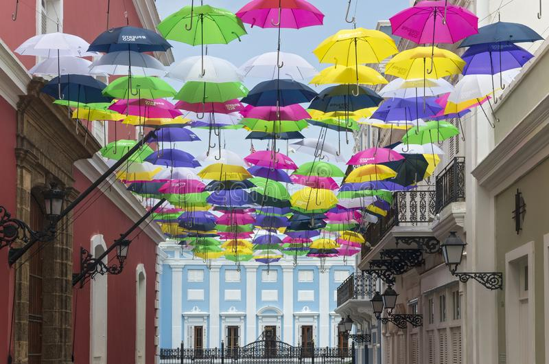 Umbrellas Above San Juan Streets and Mansion. San Juan, PUERTO RICO - August 4, 2018:Colonial architecture of Old San Juan with the Governor's Mansion in royalty free stock photos