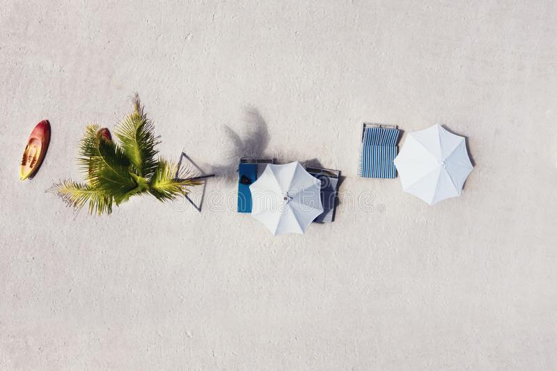Umbrellas as a background from top view. Beach and sand background from top view. Summer seascape from air. Bali island, Indonesia. Travel - image royalty free stock image