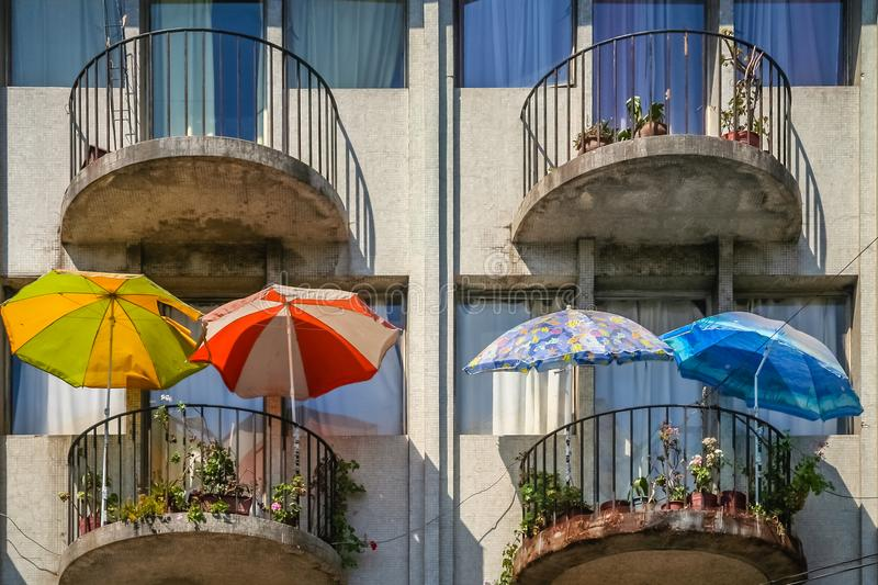 Umbrellas on the balconies of residential block of flats. In Chile, South America stock images
