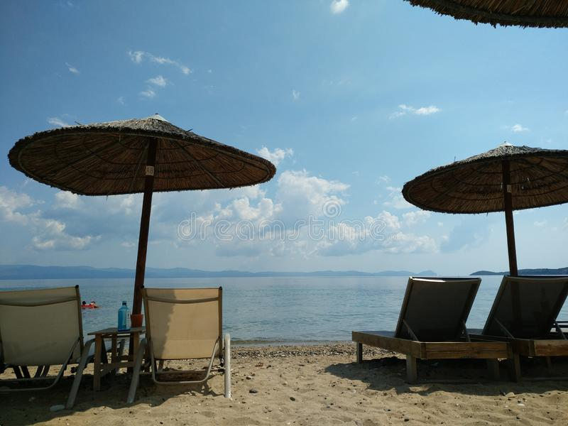 Umbrellas and beach beds, Halkidiki Greece. Background, outdoor, nobody, idyllic, awesome, summer, vacation, sun, sea, tourism, travel, destination royalty free stock images