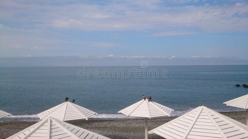 Umbrellas on the beach. In the morning stock photography
