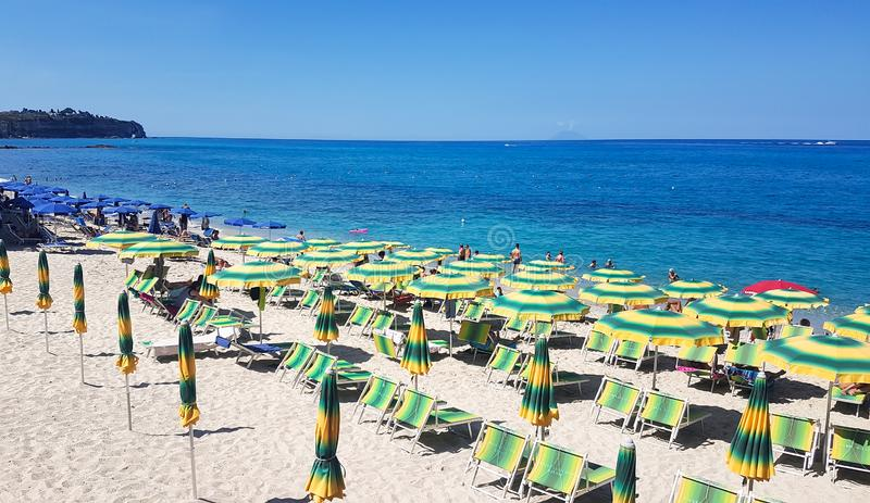 Umbrellas beach in the summer day. Tropea, southern Italy.  stock image