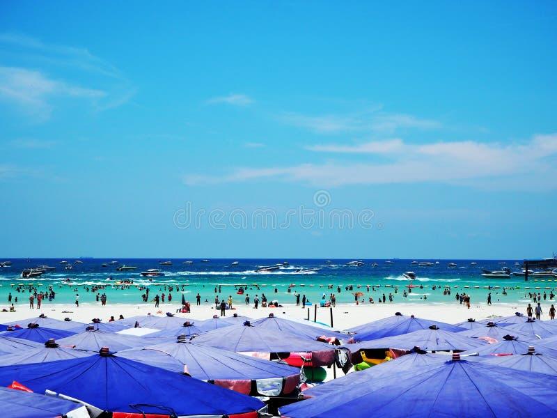 Umbrellas on a beach. With a view of a horizon line over the sea, Blue sky stock photos
