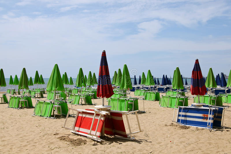 Umbrellas and deck chairs on the beach stock photos