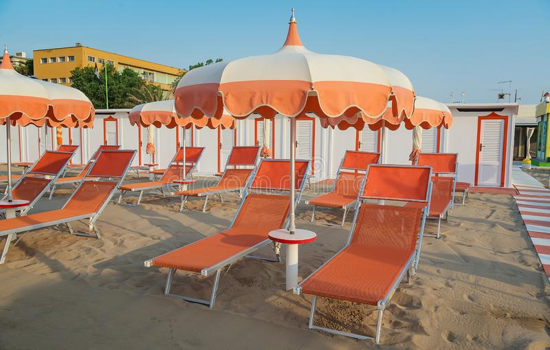 Umbrellas and deck chairs on the beach in the morning of Rimini in Italy royalty free stock photography