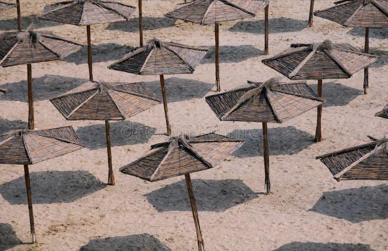 Umbrellas on the Empty Beach. Multiple umbrellas on the empty beach royalty free stock images