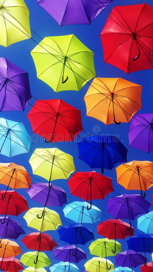 Umbrellas flying in sky royalty free stock photography
