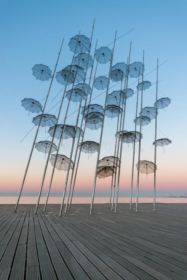 The `Umbrellas` installation at the New Waterfront of Thessaloniki during sunrise in Greece royalty free stock photography