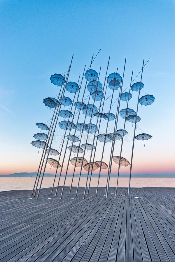 The `Umbrellas` installation at the New Waterfront of Thessaloniki during sunrise in Greece.  royalty free stock photo