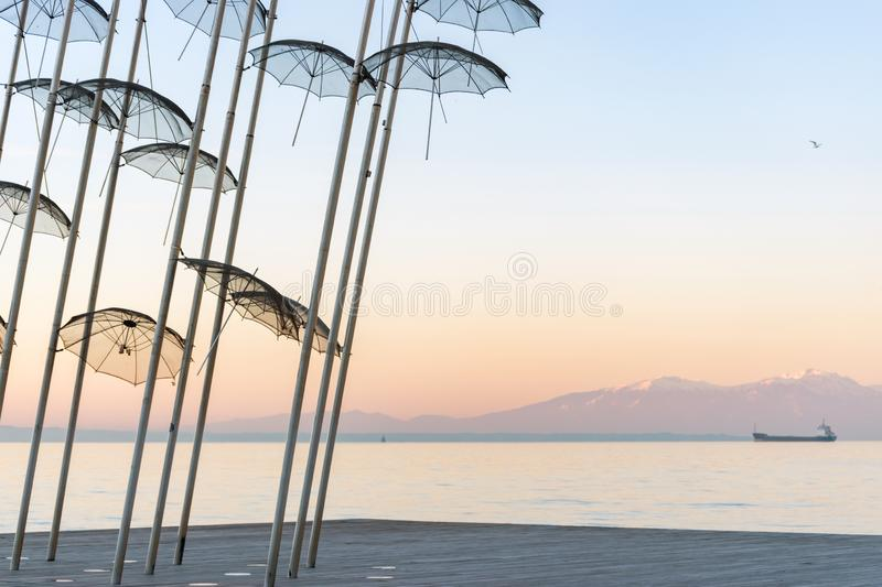 The `Umbrellas` installation at the New Waterfront of Thessaloniki during sunrise in Greece.  royalty free stock image