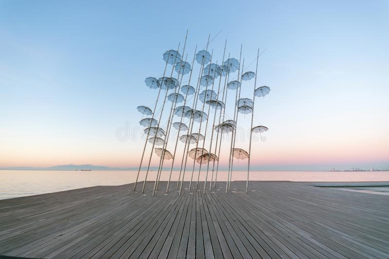 The `Umbrellas` installation at the New Waterfront of Thessaloniki during sunrise in Greece.  stock photo