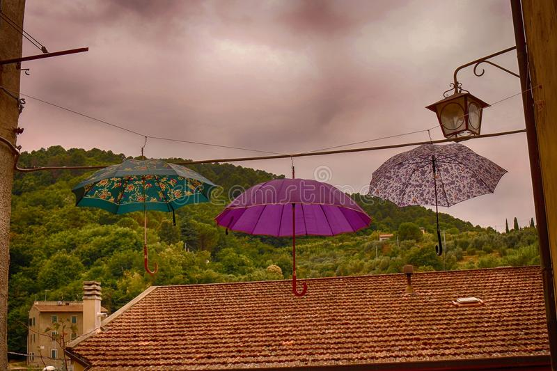Umbrellas in Italy. In the willage Chianni stock images
