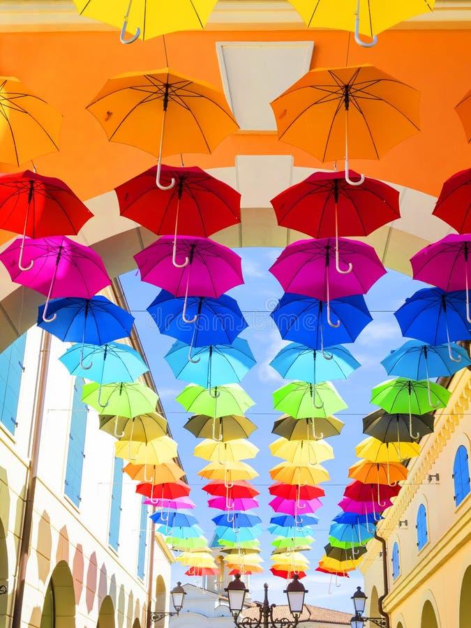 Umbrellas. Lots of umbrellas coloring the sky stock images