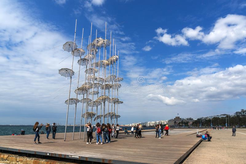 Umbrellas sculpture at Coastal street in city of Thessaloniki, Central Macedonia, Greec. THESSALONIKI, GREECE - SEPTEMBER 30, 2017: Umbrellas sculpture at royalty free stock images
