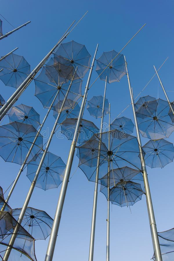 Umbrellas sculpture in Thessaloniki, Greece. THESSALONIKI, GREECE - SEPTEMBER 22, 2019: Umbrellas sculpture at embankment of city of Thessaloniki, Central royalty free stock photos
