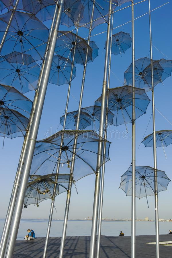 Umbrellas sculpture in Thessaloniki, Greece. THESSALONIKI, GREECE - SEPTEMBER 22, 2019: Umbrellas sculpture at embankment of city of Thessaloniki, Central stock images
