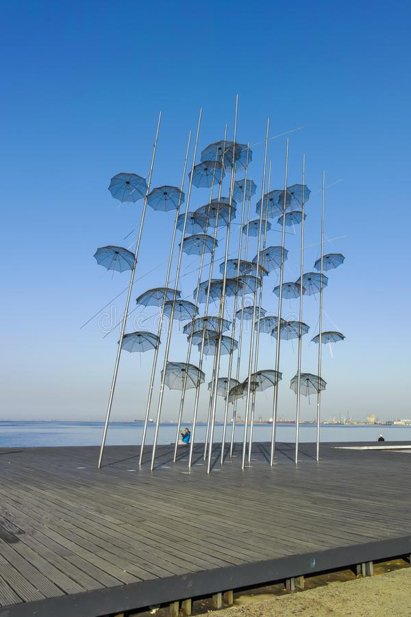 Umbrellas sculpture in Thessaloniki, Greece. THESSALONIKI, GREECE - SEPTEMBER 22, 2019: Umbrellas sculpture at embankment of city of Thessaloniki, Central royalty free stock photography