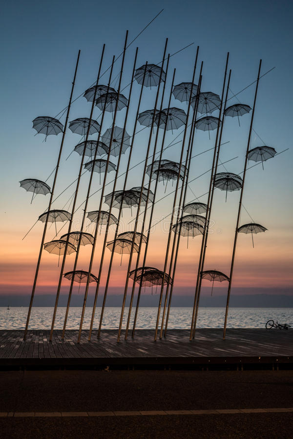 Umbrellas statue at Colors of Sunset, Thessaloniki. Greece stock photography