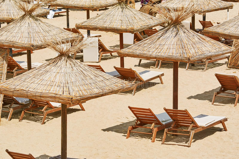 Umbrellas and Sun Loungers royalty free stock images