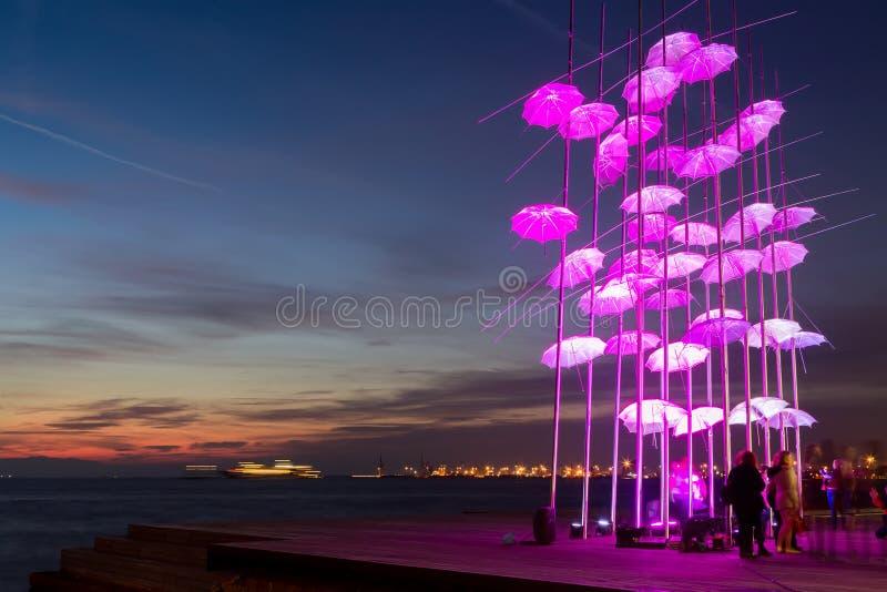 Umbrellas of Thessaloniki, Greece. The sculpture was illuminated stock photo