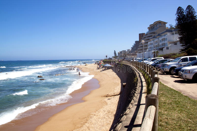 Umdloti Beach Seascape in Durban, South Africa. DURBAN, SOUTH AFRICA - DECEMBER 18, 2014: Many unknown visitors on Umdloti Beach in Durban, South Africa royalty free stock photography