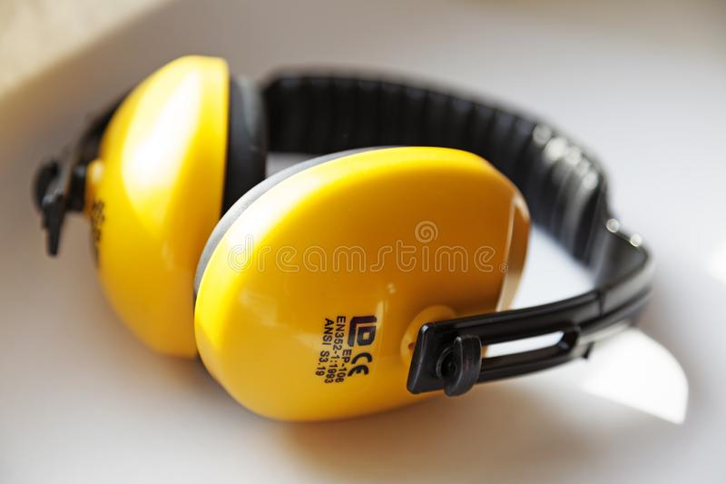 Yellow and black hearing protectors. Umea, Norrland Sweden - August 29, 2019: yellow and black hearing protectors stock photos