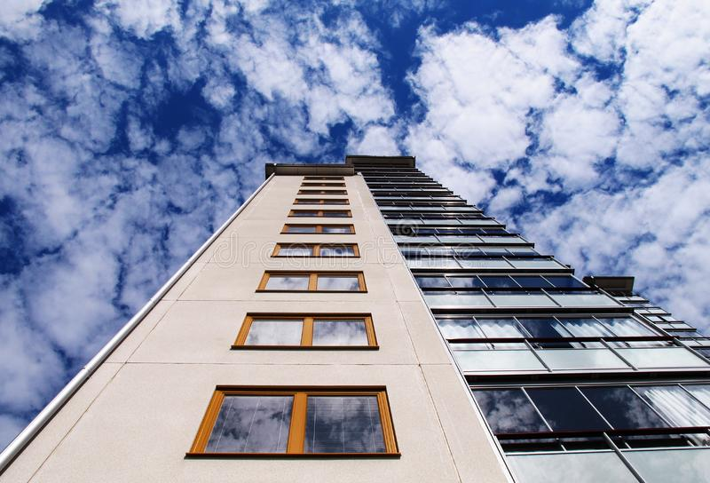 Modern apartment building extends towards the sky royalty free stock photo