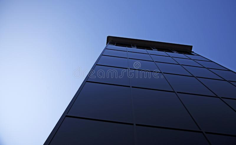 New modern hotel with black glass facade in the center royalty free stock images