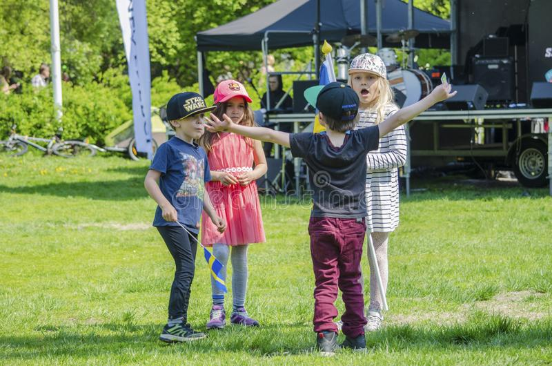 Umea, Sweden - June 6, 2019 Swedish kids celebrating swedish national day in a park with friends royalty free stock photos