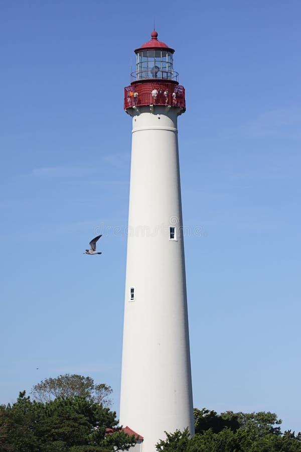 Umhang mag Leuchtturm lizenzfreie stockbilder