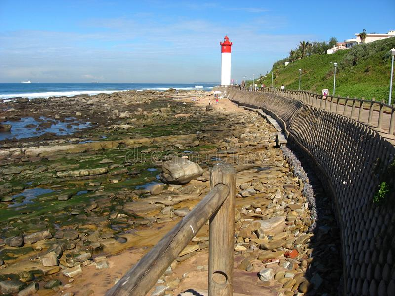 The Umhlanga lighthouse is a well known landmark just north of Durban, South Africa. Storms washed a lot of sand away in front of it, but this has slowly been stock photography