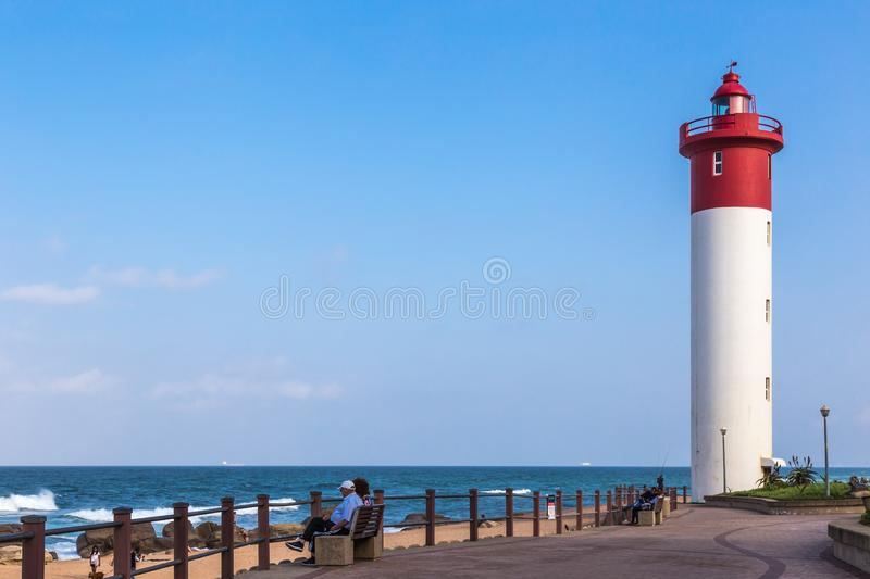 Umhlanga Rocks, South Africa, August 5, 2017: View along the promenade towards the lighthouse royalty free stock photo