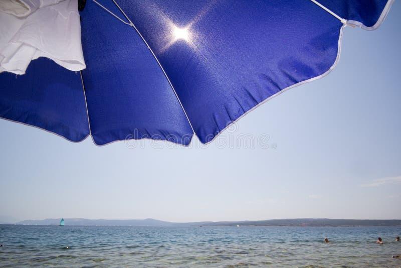 Umrella van het strand stock afbeeldingen