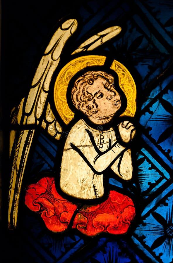 Un ángel en rezo fotos de archivo