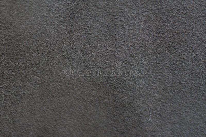 Un échantillon de tissu en cuir foncé pour la couture image libre de droits