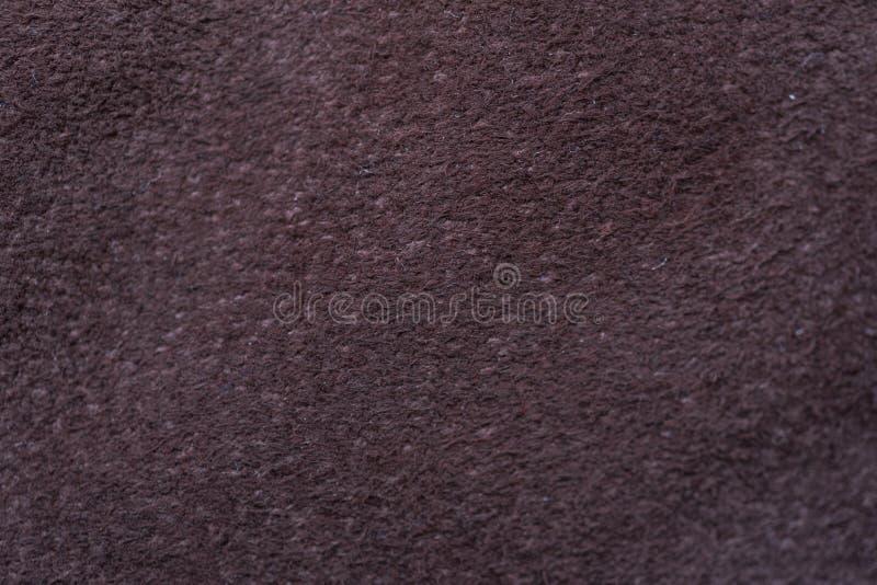 Un échantillon de tissu en cuir foncé pour la couture photos stock
