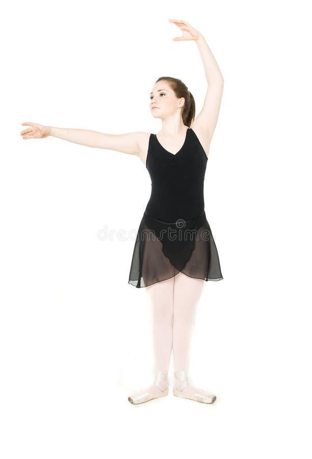 Un étirage de jeune fille photo libre de droits