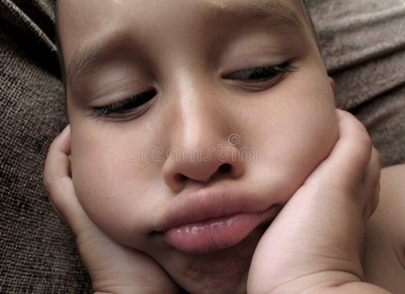 Un altro ragazzo triste fotografia stock libera da diritti