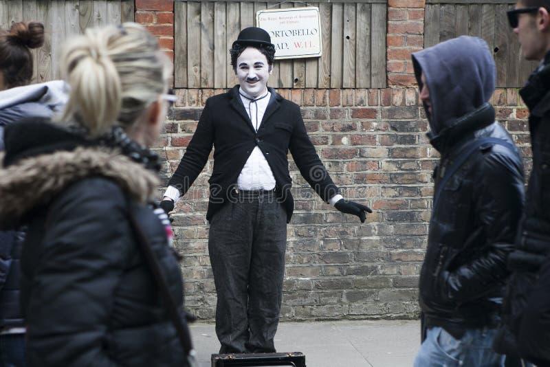 Un artista no identificado parece Charlie Chaplin foto de archivo