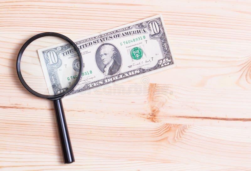 Un'autenticazione di dieci dollari di banconota immagine stock