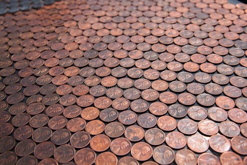 Un Auto-pieno dei penny fotografie stock