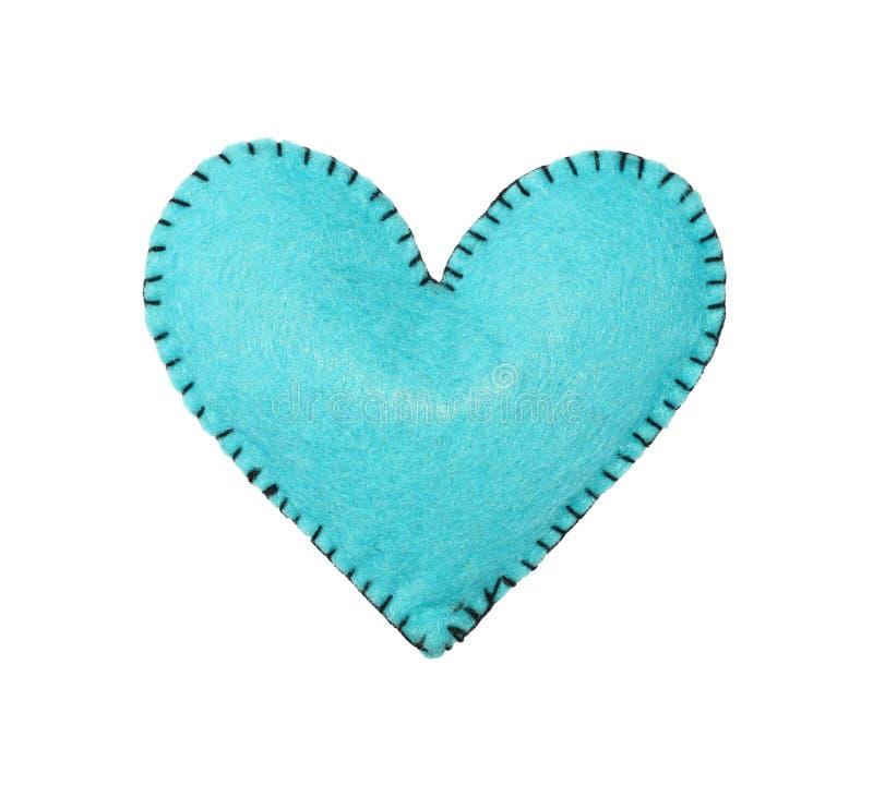 Un azul sentía el corazón cosido aislado en blanco imagen de archivo libre de regalías
