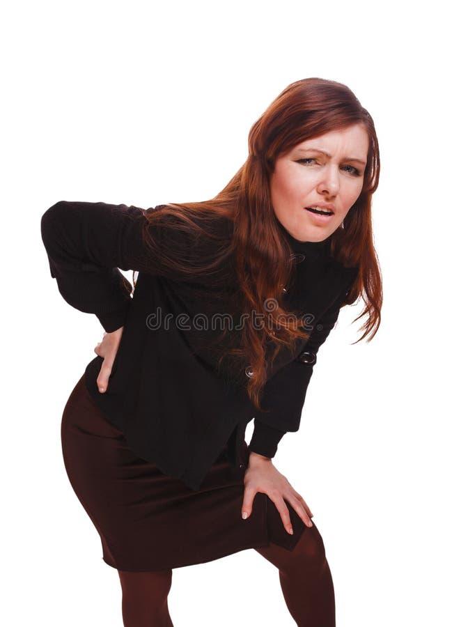 Un backac joven más bajo del osteochondrosis del dolor de lesión femenina trasera de la mujer foto de archivo libre de regalías