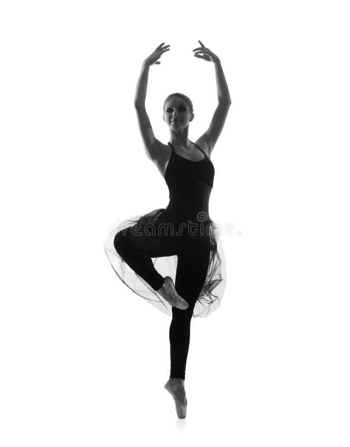 Un bailarín de ballet caucásico joven en un vestido negro imagenes de archivo